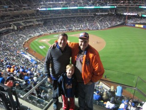 Justin Arnold knows how to dress for a Mets playoff game. He and his dad know how to bring their team luck, too.