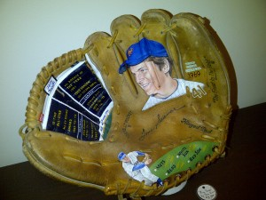 If you can't have Tom Seaver's hand in a baseball glove or all his teammates' signatures adorning baseball glove, how about the Franchise's face front and center on a baseball glove? This is the brilliant work of Sean Kane, as seen at Bergino Baseball Clubhouse.